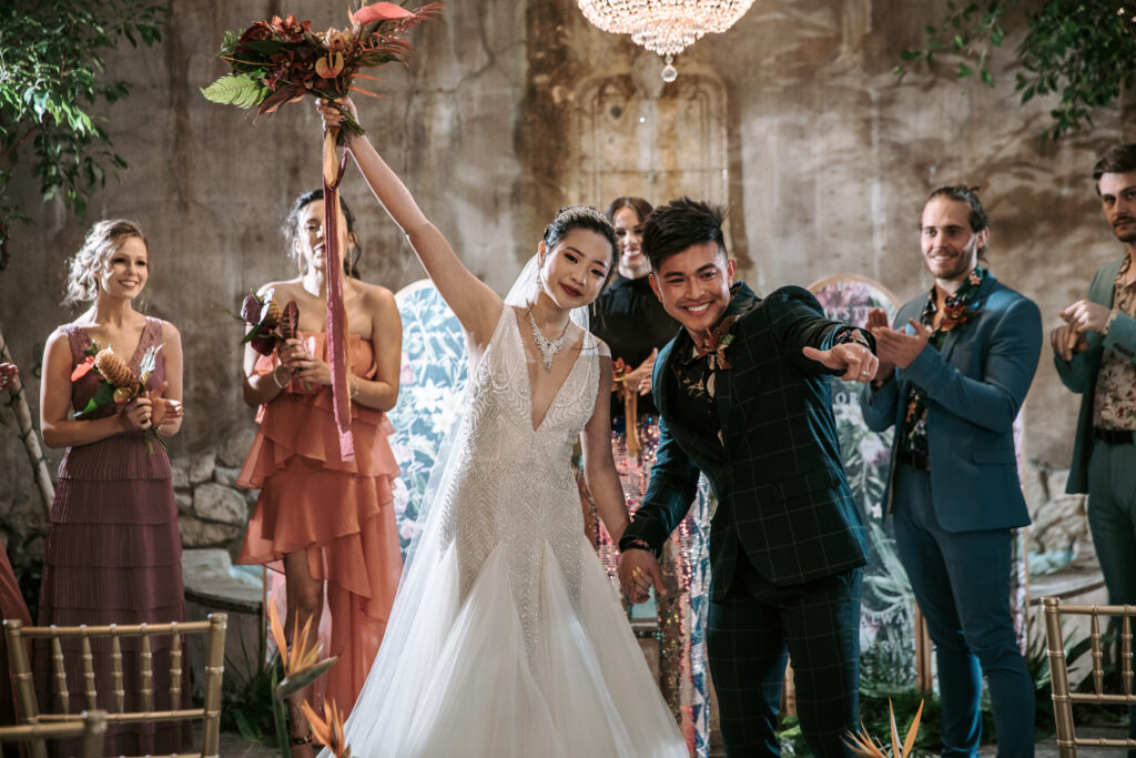 A newlywed asian couple celebrated with their family and friends at a Utah Wedding
