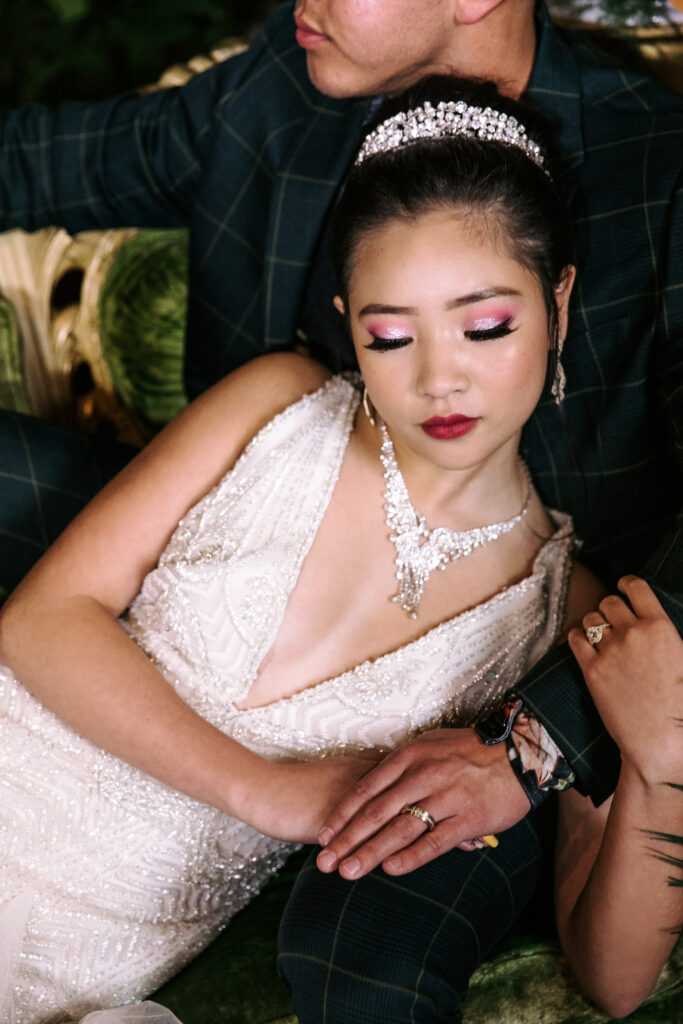 Bride with a diamond crown and necklace with pink glam makeup