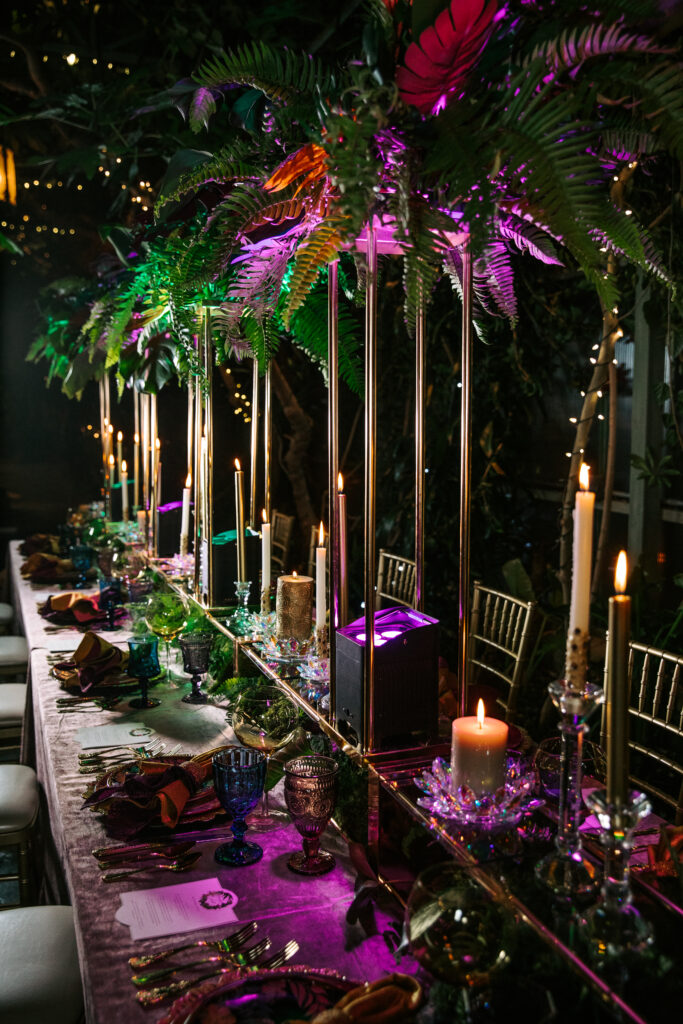 A tropical theme wedding table scape with candles and glass flowers for wedding ideas