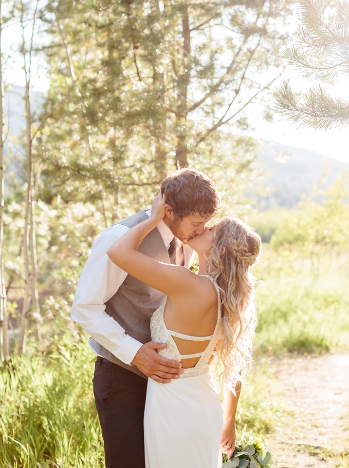 Mountain elopement with an in love couple with blonde hair with a bridal style of two braids