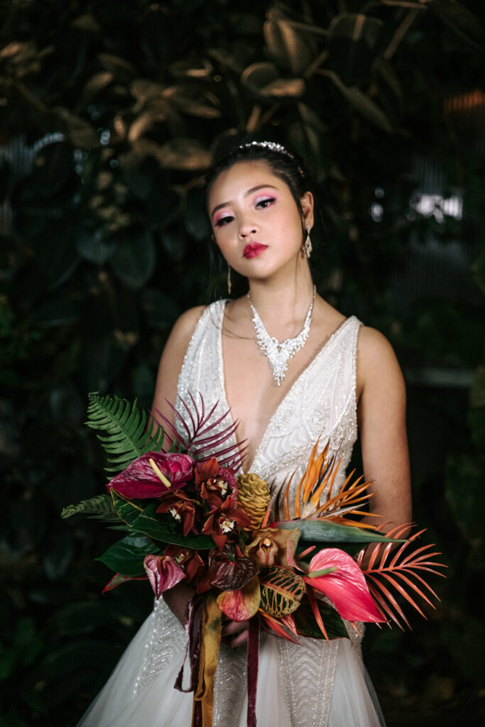 An asian bride with bridal glamour makeup and custom lip color