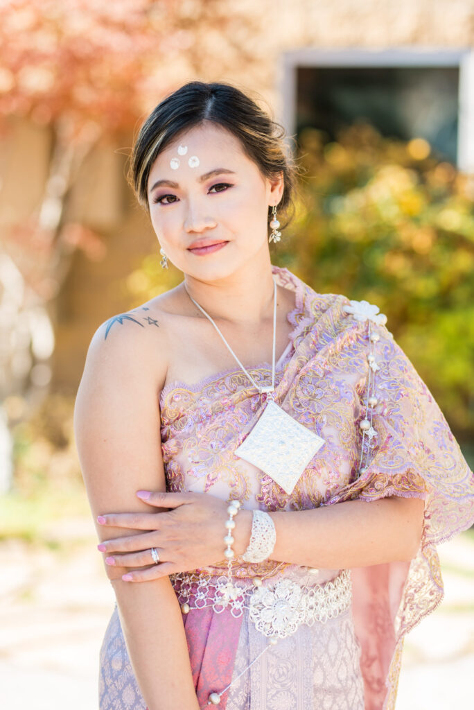 Beautiful asian bride in pink gown
