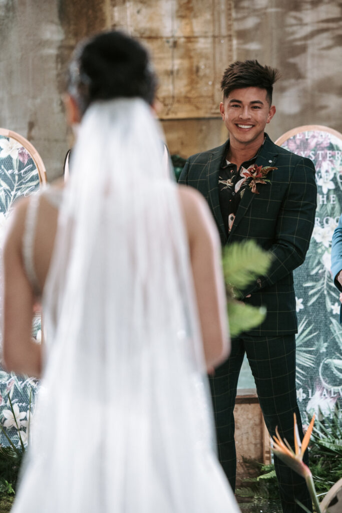 An asian, filipino groom seeing his bride for the very first time