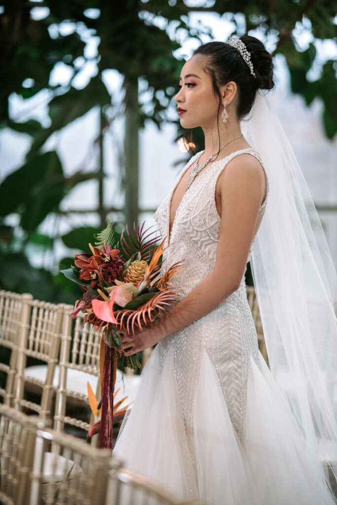 Asian bride with a glam makeup with tropical bouquet