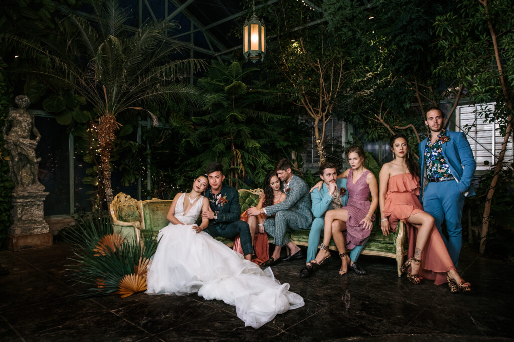The wedding bridal party for a Utah wedding with muted color dresses and colored suits