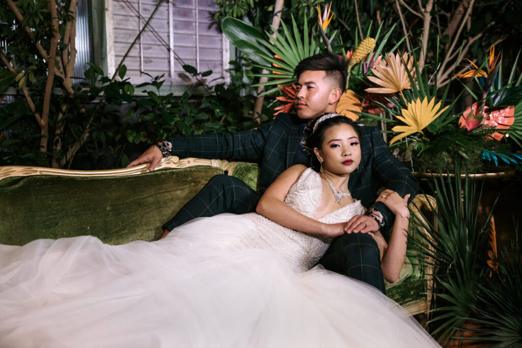 An asian couple in a utah wedding with glam makeup with a wedding updo finished with a crown
