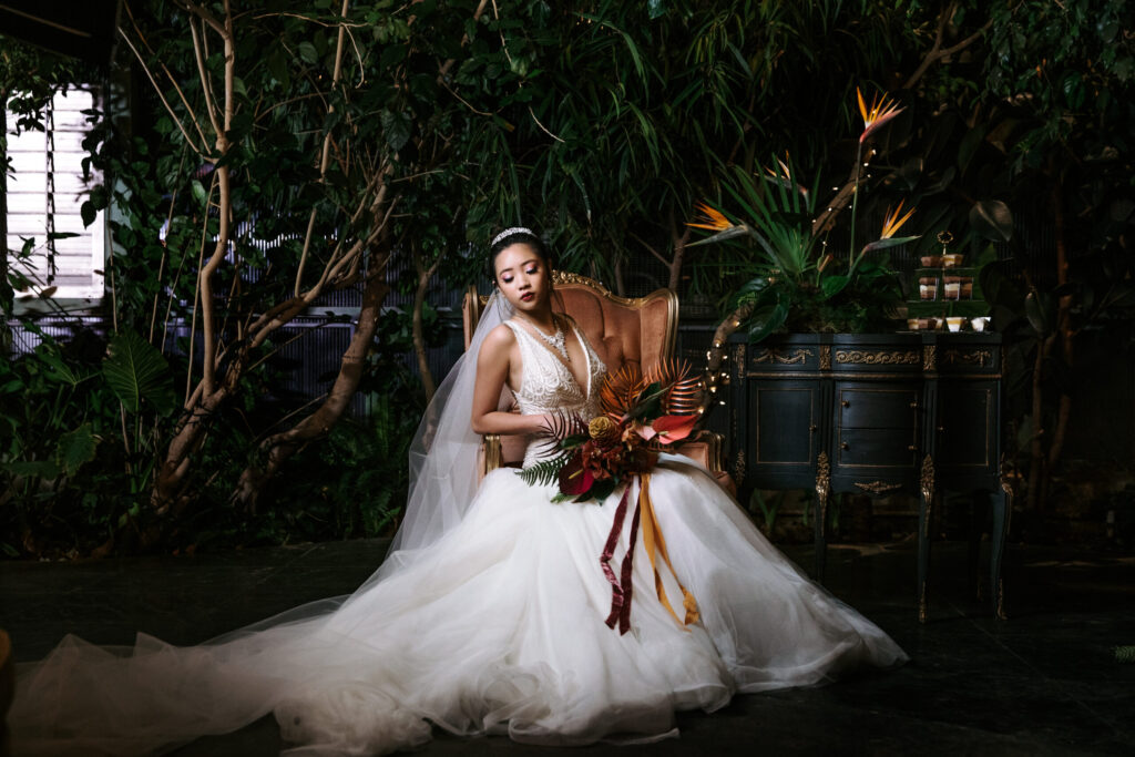 Asian Bride with Dramatic light and a tropical bouquet