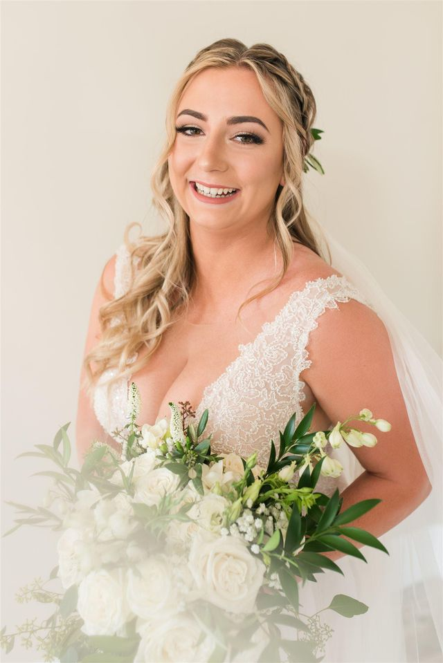 Bride with winged liner and braided wedding style